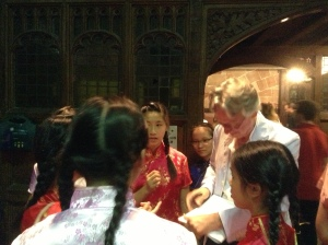 Charles Bennett signing scripts for choir members from Hong Kong.