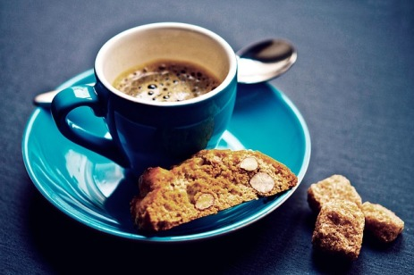 Coffee in blue cup and biscuits
